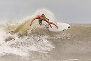 Surfers ride waves churned up as Hurricane Arthur passes off shore bringing high surf and rip tides to the beaches along the South Carolina coast July 3, 2014 in Folly Beach, SC. The first hurricane of the season passed far off the South Carolina coast causing no damage and little rain.