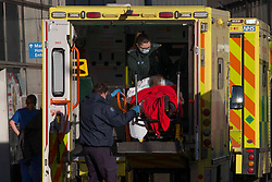 **face of patient pixelated to hide identity**<br /> © Licensed to London News Pictures.25/01/2021, London,UK. A patient is transferred on stretcher from an ambulance at the Royal London Hospital in east London as the third national lockdown continues and hospitals are struggling to cope with the number of admissions. Photo credit: Marcin Nowak/LNP