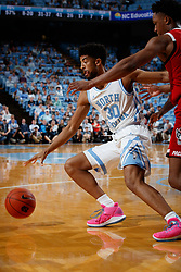 CHAPEL HILL, NC - FEBRUARY 05: K.J. Smith #30 of the North Carolina Tar Heels plays during a game against the North Carolina State Wolfpack on February 05, 2019 at the Dean Smith Center in Chapel Hill, North Carolina. North Carolina won 113-96. North Carolina wore retro uniforms to honor the 50th anniversary of the 1967-69 team. (Photo by Peyton Williams/UNC/Getty Images) *** Local Caption *** K.J. Smith