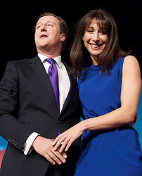 Conservative Party Conference, ICC, Birmingham, Great Britain <br /> 10th October 2012 <br />  Day 4<br /> <br /> Rt Hon David Cameron MP <br /> Prime minister <br /> keynote speech <br /> with wife Samantha Cameron <br /> <br /> <br /> Photograph by Elliott Franks<br /> <br /> United Kingdom<br /> Tel 07802 537 220 <br /> elliott@elliottfranks.com<br /> <br /> ©2012 Elliott Franks<br /> Agency space rates apply