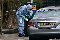 © Licensed to London News Pictures. 06/12/2016. London, UK. Police forensics taking fingerprints at the scene of a murder in Fulham, where a 24 year old man was found with a gunshot wound to the head at 21:30hrs on Monday, 5 December. The man was pronounced dead at the scene. Photo credit : Tolga Akmen/LNP