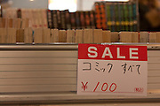 A sign offering second hand books for a hundred Yen at a week long secondhand book market outside Shimbashi station in Tokyo. Japan The market runs from November 15th to November 21st and takes place every 5 months. Japan has a 99% literacy rate and boasts a large publishing market that has however been in steep decline since the 1990s when due to Japan`s lowering economic conditions companies like Book Off, that opened its first store in 1990 and now circulates over 200 million books a year through nearly 900 stores nationwide and internationally made the buying and selling of secondhand books popular and acceptable. Shimbashi, Tokyo, Japan November 18th 2009