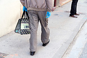 man walking with surgical gloves during the Covid 19 crisis and lockdown France Limoux April 2020