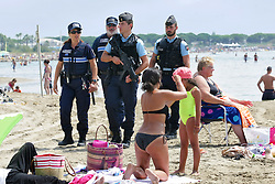 Armed national and municipal police forces as well as military officers patrol the beaches in Le Grau-du-Roi, southern France on August 4, 2016. Photo by Pascal Parrot/ABACAPRESS.COM
