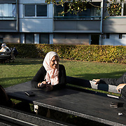 Daily life in the sun. Naima with her sisters. Lundtoftegade is a housing estate in the heart of Copenhagen. The estate has been on the controversial Ghetto List for years but wastaken off 1st of December 2020. The Ghetto List is based on the Ghetto Law introduced by the Danish Govenrment in 2018. In 2020 a huge campaign was launched to raise 50.000 signatures demanding the Danish Parliament to reconsider the law and to abolish it. Part of the campaign was the national portrait poster campaign 'We ARE the mixed city'. More than 100 local residents in joined the campaign and were photographed in a small make shift studio set up in Lundtoftegade. These images are fragments of life in and around Lundtoftegade 2020.