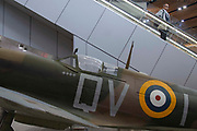A close up of the cockpit of a replica Supermarine Spitfire installed on the concourse at London Bridge Station on 31st May 2019 in London, England, United Kingdom. Installed by the Imperial War Museum to mark 75 years since the D-Day landings. Four swastikas are painted on the plane below the cockpit signalling how many German planes were shot down.