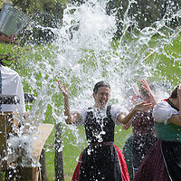 Girls wearing traditional dresses run from buckets of water splashed on them as part of the fertility traditions during the Easter watering celebration in the Skansen open air ethnographic museum in Szenna (about 200 km South-West of capital city Budapest), Hungary on April 14, 2017. ATTILA VOLGYI