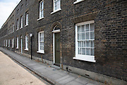 Classic Georgian terraced street of houses in Waterloo in London, United Kingdom. Roupell Street consists of nineteenth-century workers cottages, and was first developed in the 1820s. This is on one of the capitals better-preserved streets after many were destroyed during the Blitz in WW2. Roupell Street is a preservation area whose are from the Georgian period in a backstreet.