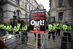 © Licensed to London News Pictures . 20/06/2015 . London , UK . Police on guard outside Downing Street . Tens of thousands of people march from the Bank of England to Parliament , to protest economic austerity in Britain . Photo credit: Joel Goodman/LNP
