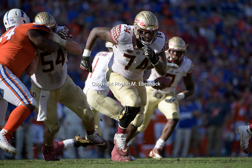 Florida State offensive lineman Derrick Kelly II (74) sets up block during the second half of an NCAA college football game against Florida Saturday, Nov. 25, 2017, in Gainesville, Fla. FSU won 38-22. (Photo by Phelan M. Ebenhack)