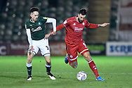 Ollie Palmer (9) of Crawley Town battles for possession with Ryan Hardie (18) of Plymouth Argyle during the EFL Sky Bet League 2 match between Plymouth Argyle and Crawley Town at Home Park, Plymouth, England on 28 January 2020.