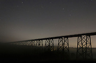 Salisbury Mills, New York  - Stars shine above and fog forms below the Moodna Viaduct railroad trestle on the night of Sept. 29, 2013.