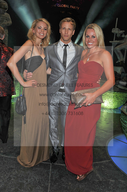 Left to right, SORREL ROSE, RICK PARFIT JNR and Leading British skiier CHEMMY ALCOTT at The Global Party held at The Natural History Museum, Cromwell Road, London on 8th September 2011.