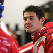 Driver Kyle Larson talks with his crew after his practice run for the 56th Annual NASCAR Daytona 500 race at Daytona International Speedway on Wednesday, February 19, 2014 in Daytona Beach, Florida.  (AP Photo/Alex Menendez)