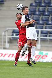 Carl Finnigan gets held by Michael Stegmayer.<br /> Falkirk v FC Vaduz, Europa League Qualifying.<br /> ©2009 Michael Schofield. All Rights Reserved.