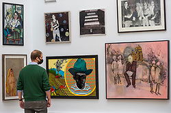 """© Licensed to London News Pictures. 28/09/2020. LONDON, UK. A staff member views  (C) """"Damsel on Distress"""" by Fiona White.  Preview of the Summer Exhibition at the Royal Academy of Arts in Piccadilly which, due to the Covid-19 lockdown, is taking place for the first time in the autumn.  Over 1000 works in a range of media by Royal Academicians, established and emerging artists, feature in the exhibition which runs from 6 October 2020 – 3 January 2021.  Photo credit: Stephen Chung/LNP"""
