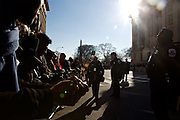 People wait for the inauguration parade to begin for Pres. Barack Obama on January 21, 2013 in Washington, D.C.