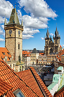 Prague's Old Town Square with old town hall bell tower with The Church of Our Lady Before Tyn in the background.
