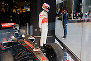 A Formula 1 mannequin of McLaren driver Jenson Button on the opening day of the Westfield Stratford shopping mall. Situated on the fringe of the 2012 Olympic park, Westfield hosted its first day to thousands of shoppers eager to see Europe's largest urban shopping centre. The £1.45bn complex houses more than 300 shops, 70 restaurants, a 14-screen cinema, three hotels, a bowling alley and the UK's largest casino. It will provide the main access to the Olympic park for the 2012 Games and a central 'street' will give 75% of Olympic visitors access to the main stadium so retail space and so far 95% of the centre has been let. It is claimed that up to 8,500 permanent jobs will be created by the retail sector.