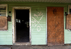 20 August 2015. New Orleans, Louisiana. <br /> Hurricane Katrina revisited. <br /> A decade later and the all too familiar signs of the storm remain on a derelict house in the lower 9th Ward. Recovery remains largely elusive for the area hardest hit by Katrina.<br /> Photo credit©; Charlie Varley/varleypix.com.