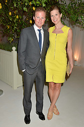 GUY & ELIZABETH PELLY at a dinner hosted by Cartier in celebration of The Chelsea Flower Show held at The Hurlingham Club, London on 19th May 2014.