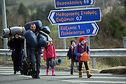 March 1, 2016 - Athens, Greece - <br /> <br /> Syrian refugees walk through a motorway in their effort to arrive the Greek border station of Idomeni. Some 7,000 migrants, including many from Syria and Iraq, are crammed into a tiny camp at the Greek border village of Idomeni, and hundreds more are arriving daily.<br /> ©Exclusivepix Media