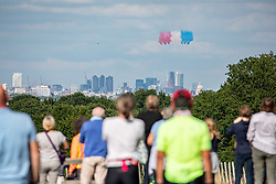 © Licensed to London News Pictures. 18/06/2020. London, UK. Huge crowds gathered in Richmond Park, South West London today as the Red Arrows and the French Patrouille de France fly over the park releasing smoke in the colours of the French flag as they head to central London to mark Emmanuel Macron's visit to the UKfor the 80th anniversary of Charles de Gaulle's rallying cry to resist the Nazis. Photo credit: Alex Lentati/LNP