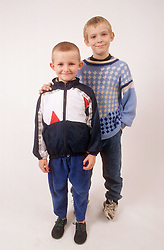 Studio portrait of two young boys smiling,