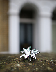 © Licensed to London News Pictures. 11/01/2016. London, UK. A decoration is left in tribute outside the Brixton house that David Bowie lived in. The Death of David Bowie, who was born in Brixton, has been announced today.  Photo credit: Peter Macdiarmid/LNP