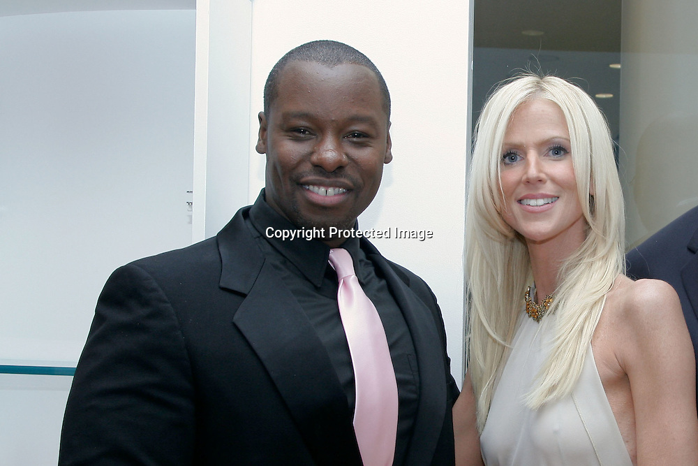 """090924-CHEVYCHASE- Michaele Salahi(R), cast members of the up and coming Bravo show """"The Real Housewives of DC,"""" poses with stylist Ted Gibson(L) during the grand opening of his newnew salon in Chevy Chase, Md on September 24, 2009."""