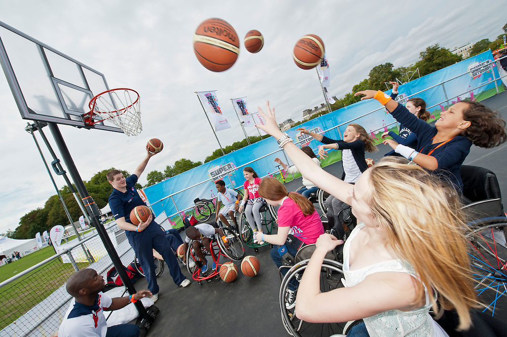 Vistors have a go a wheelchair basketball - coached by Tyler Saunders of the GBR team. Sainsbury's host Sainsbury's Super Saturday on Clapham Common – an event to celebrate and raise awareness of the London 2012 Paralympic Games and help celebrate the one year to go milestone until the Paralympic Games begin. Alongside the music, revellers are treated to demonstrations of Paralympic sports such as Wheelchair Basketball and Goalball, as well as being given the opportunity to try the sports themselves