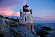 Castle hill light house with pink storm clouds, Newport, RI