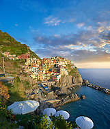 fishing village and harbour of Manarola at sunset , Cinque Terre National Park, Liguria, Italy .<br /> <br /> Visit our ITALY HISTORIC PLACES PHOTO COLLECTION for more   photos of Italy to download or buy as prints https://funkystock.photoshelter.com/gallery-collection/2b-Pictures-Images-of-Italy-Photos-of-Italian-Historic-Landmark-Sites/C0000qxA2zGFjd_k