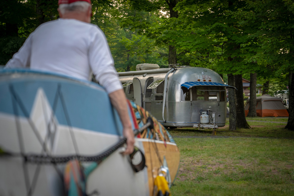 A paddleboarder returns to his campsite at Perkins Park in Big Bay, Michigan.
