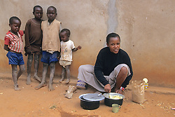 Monique Nditu Preparing Batter For Cake For Cooking In Solar Oven