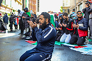 London, United Kingdom, May 22, 2021: Some protestors with strong religious belief decided to take a moment to pray outside the Israeli Embassy in Kensington, London during a pro-Palestinian rally on Saturday May 22, 2021. Egyptian mediators held talks Saturday to firm up an Israel-Hamas cease-fire as Palestinians in the Hamas-ruled Gaza Strip began to assess the damage from 11 days of intense Israeli bombardment. (Photo by Vudi Xhymshiti/VXP)