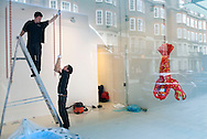 UK. London. New works by artist Jeff Koons go on show in London. Photograph shows his 'Popeye' work being hung in the Gagosian Gallery in Davies Street in Mayfair. Popeye is a body of work comprising cast aluminium sculptures based on mass-produced inflatables. Photo shows the Lobster sculpture being hung.