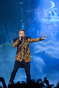 """WASHINGTON, DC - November 18, 2013 - Macklemore (left) and Ryan Lewis (right) perform at the Verizon Center in Washington, D.C. The duo is still riding high off of their 2012 album, The Heist, which contains the #1 singles """"Thrift Shop"""" and """"Can't Hold Us."""" (Photo by Kyle Gustafson / For The Washington Post)"""
