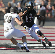 Lindenwood QB Kerry Gibson (16, right) runs the ball in the third quarter as St. Francis player Jesse Hogan (28) moves to intercept him.  Lindenwood hosted the St. Francis Fighting Saints Saturday afternoon.