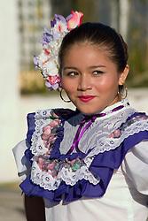 Mexico, Yucatan, Merida, teenage girl wearing traditional dress dancing in parade