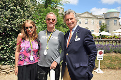 Left to right, Margaret DeVogelaere, PETER FONDA and ARNAUD BAMBERGER at a luncheon hosted by Cartier for their sponsorship of the Style et Luxe part of the Goodwood Festival of Speed at Goodwood House, West Sussex on 5th July 2009.
