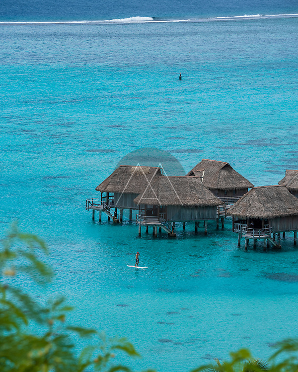 View of a luxury resort with tourists on Moorea island, French Polynesia.