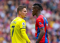 Football - 2021/2022  Premier League - Crystal Palace vs Brentford - Selhurst Park  - Saturday 21st August 2021.<br /> <br /> Wilfried Zaha (Crystal Palace) confronts Sergi Canos (Brentford FC) as things do not go his way at Selhurst Park.<br /> <br /> COLORSPORT/DANIEL BEARHAM