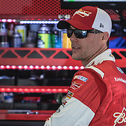 NASCAR champion Kevin Harvick is seen in the garage area during the last practice session for the 57th Annual NASCAR Daytona 500 race at Daytona International Speedway on Saturday, February 21, 2015 in Daytona Beach, Florida.  (AP Photo/Alex Menendez)