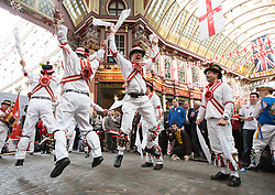 LNP HIGHLIGHTS OF THE WEEK 25/04/14 © Licensed to London News Pictures. 23/04/2014. London, UK. The Ewell St Mary's Morris Men dance for George's day at Leadenhall Market in the City of London. Photo credit : Vickie Flores/LNP