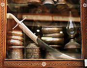 Antique metal works for sale in the window of a store in the Christian quarter in Damascus, Syria