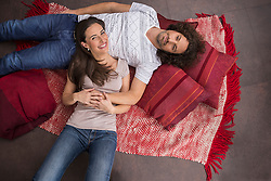 High angle view of mid adult couple lying on floor, Munich, Bavaria, Germany