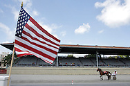 A horse warms up at Goshen's Historic Track before the start of racing on Thursday, July 4, 2013.