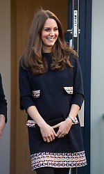 Catherine, Duchess of Cambridge, wearing a loose fitting maternity dress by Madderson, visits Barlby Primary School in West London to officially name the Clore Art Room on January 15, 2015.