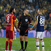 Referee's Cuneyt Cakir (C) during their Turkish superleague soccer derby Fenerbahce between Galatasaray at the Sukru Saracaoglu stadium in Istanbul Turkey on Sunday 08 March 2015. Photo by Kurtulus YILMAZ/TURKPIX